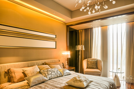 upscale: luxury hotel bedroom with upscale furniture and modern style decoration