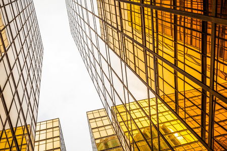 modern buildings: low angle view of modern skyscraper exterior and sky in modern city