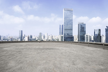 Modern city skyline and empty cement square