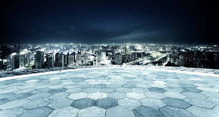 Empty footpath and panoramic modern skyline at night Banco de Imagens