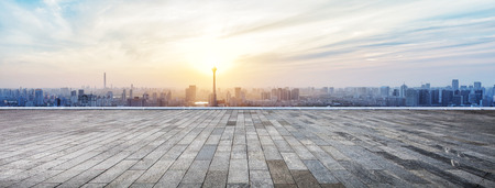 Panoramic skyline and buildings with empty wooden board Stock Photo