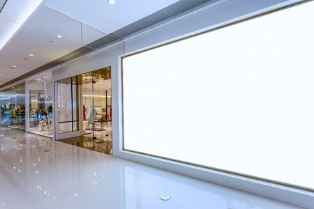 shop interior: Empty blank billboard in shopping mall interior Editorial