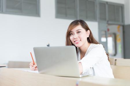 niñas chinas: Asian  beautiful female student study with laptop in classroom Foto de archivo