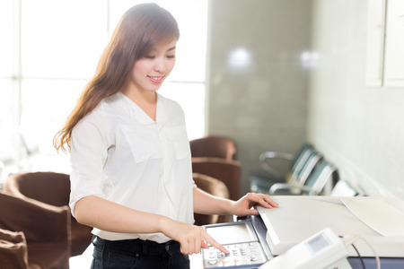 asian beautiful woman using printer in office