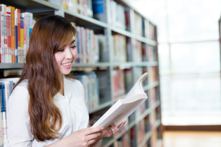 postgraduate: asian beautiful female student portrait in library Stock Photo