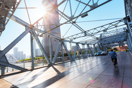 steel: Traffic on steel bridge interior and skyline at sunset Stock Photo