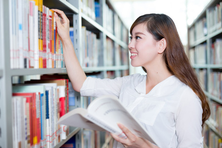 postgraduate: asian beautiful female student portrait in library Stock Photo