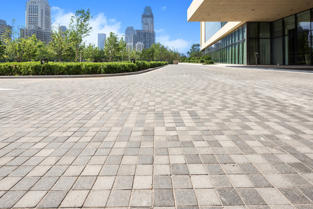 office building exterior: office building exterior with brick road floor Editorial