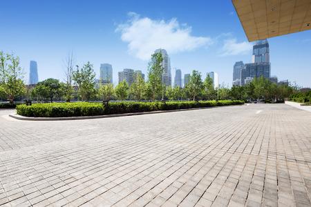 office building exterior with brick road floor Foto de archivo