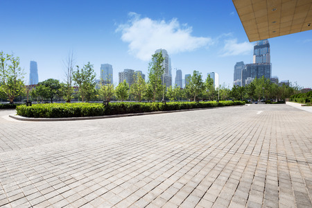 empty street: office building exterior with brick road floor Stock Photo