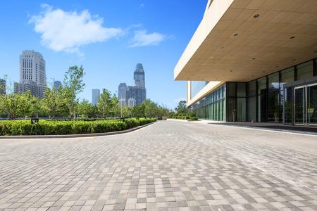 office building exterior with brick road floor Editorial