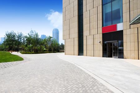 modern building exterior with brick road floor