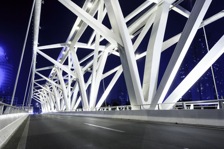 transportation travel: modern bridge with empty road floor at night