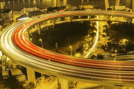 road intersection: illuminated road intersection and traffic trails