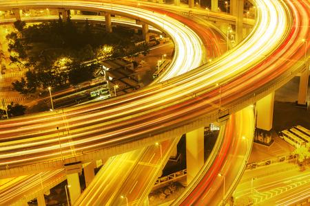illuminated: illuminated road intersection and traffic trails