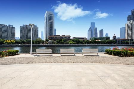 Modern skyline and empty road floor