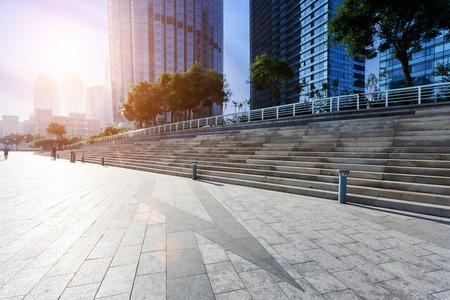 cement floor: Modern skyline and empty road floor