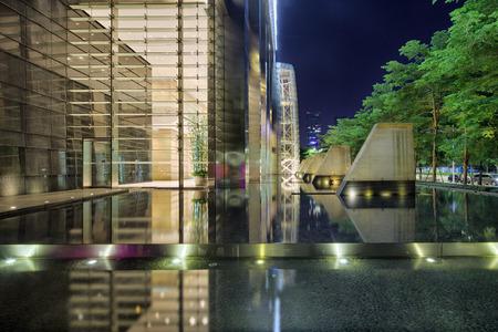 illuminated: Illuminated building exterior and footpath