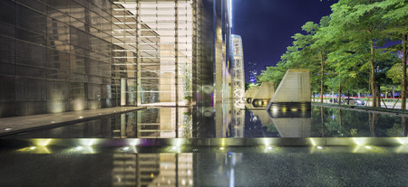 architecture design: Illuminated building exterior and footpath