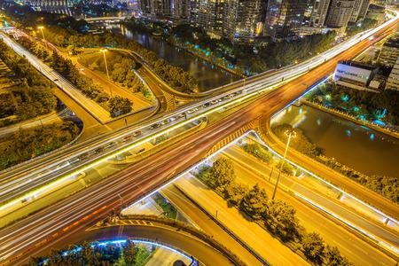 illuminated: illuminated skyline and road intersection Stock Photo