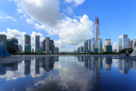 urban street: Modern skyline and buildings with empty square floor Stock Photo
