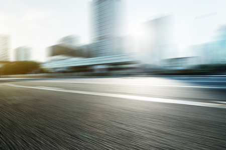 urban transport: Blurred motion of modern skyline and urban street