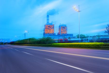 powerplant: high way road near a power powerplant Stock Photo
