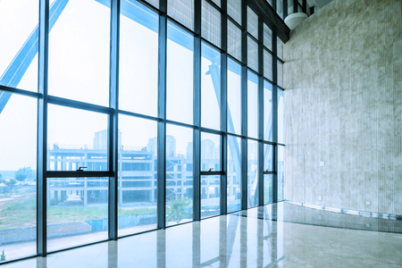 office window view: glass wall of interior space in a exhibition hall Editorial