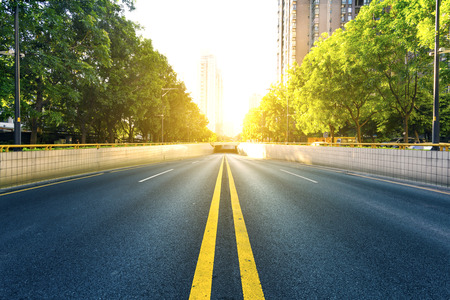 bidirectional: bi-directional road with the doubled solid lines under sunshine