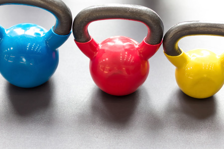 kettle bell: colorful kettle bell on table
