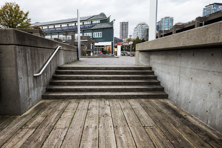 concrete steps: concrete steps and vintage wooden floor Stock Photo