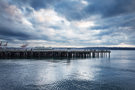 wooden dock: wooden dock on the sea in cloudy sky Stock Photo