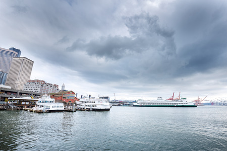 liner: yachts and liner along dock on sea in cloudy sky