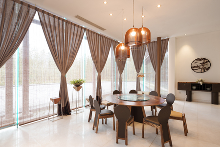 living style: furniture and decoration of modern dining room in hotel