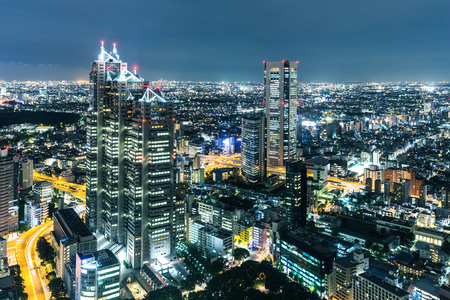 office buildings: modern office buildings in tokyo at night on view from top