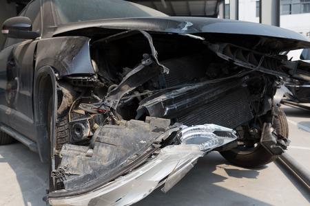 damaged: a front damaged black car Stock Photo