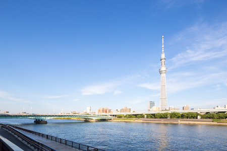 bridge,water,modern office buildings and tokyo television tower in tokyo in blue sky