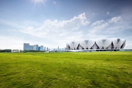 grassfield: hangzhou olympic stadium from empty grassfield with sunbeam