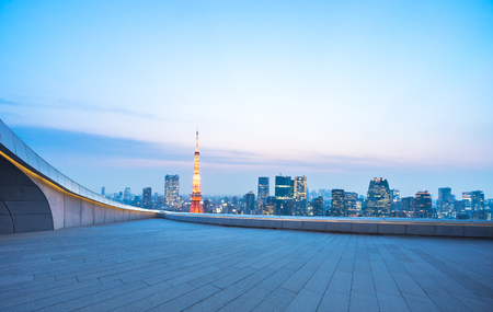 urban road: cityscape and skyline of downtown near tokyo tower at twilight