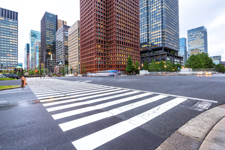 urban road: traffic on road intersection in downtown of tokyo