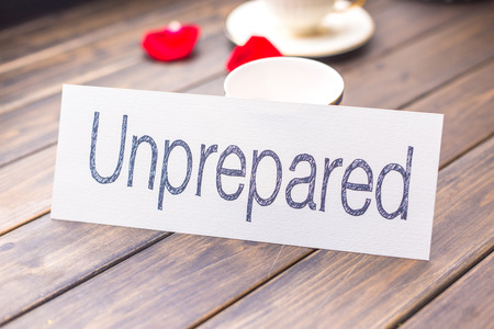unprepared: white paper with word unprepared against elegant coffee cup in cafe Stock Photo