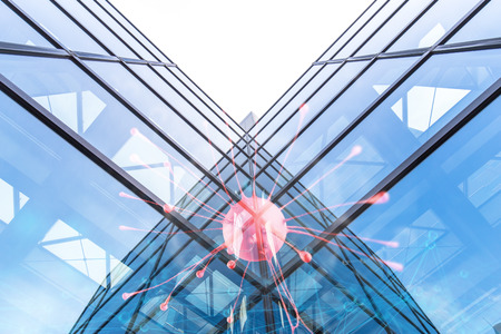 sign of red neuron on wall of modern buildings with glass wall in tokyo Stock Photo