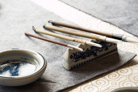 inkstone: chinese calligraphy tools on table Stock Photo