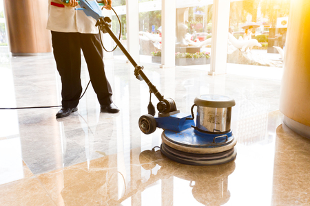 buffing: people polishes floor indoors