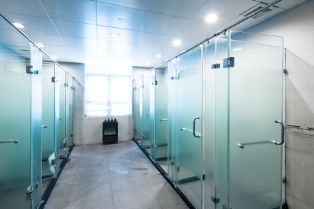 shower with glass in bathroom of gym Editorial