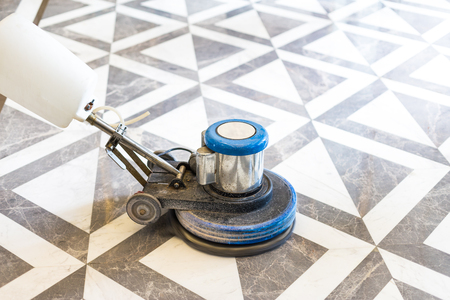 polisher working on marble floor in modern office building Banque d'images