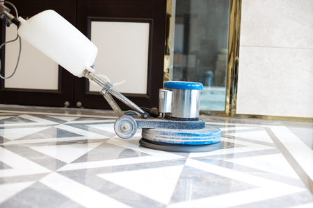polisher working on marble floor in modern office building 版權商用圖片