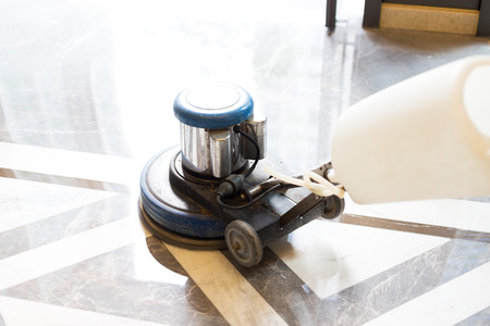 polisher working on marble floor in modern office building Stock Photo