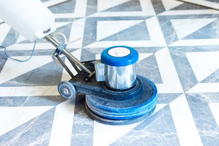 polisher working on marble floor in modern office building Standard-Bild