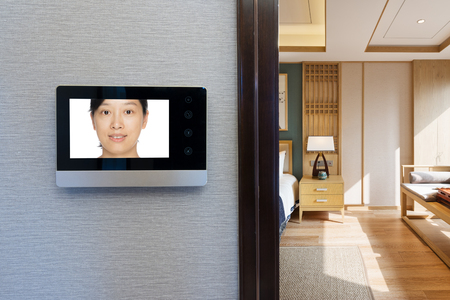 intercom video door bell on the wall outside modern dining room 報道画像